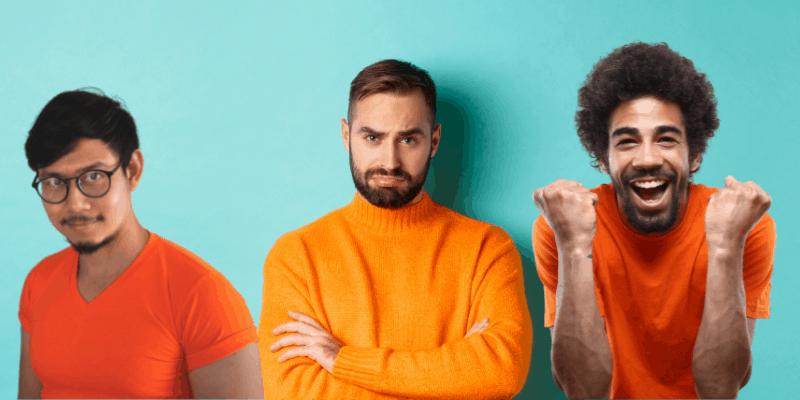 Three guys in orange shirts