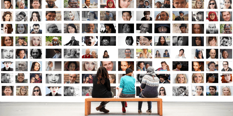 Three people sitting in front of a wall of photos—Is Dating a Global Phenomenon?