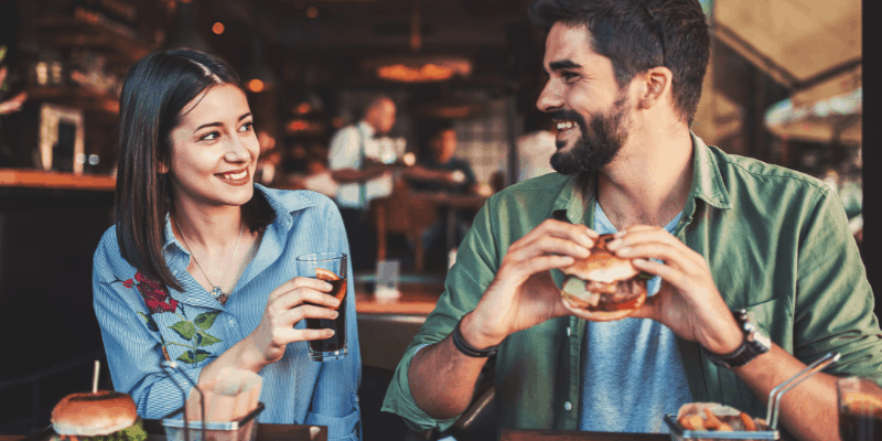 Man and woman eating on a date—Is Dating a Relationship (Fully Answered)