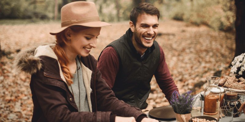 A man and woman in the woods having a picnic—Can Dating Be Platonic