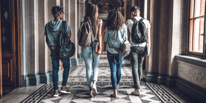 Four college students with back packs—Does Dating Get Harder After College