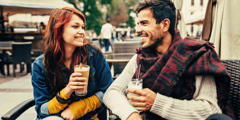A man and a woman on a date—is dating a game