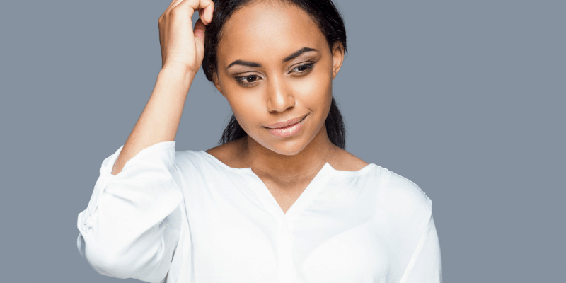 African American woman scratching her head—Is it Normal to Get Cold Feet In a Relationship