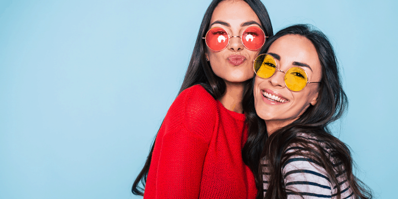 Two girls with colored sunglasses—Jealousy in friendships