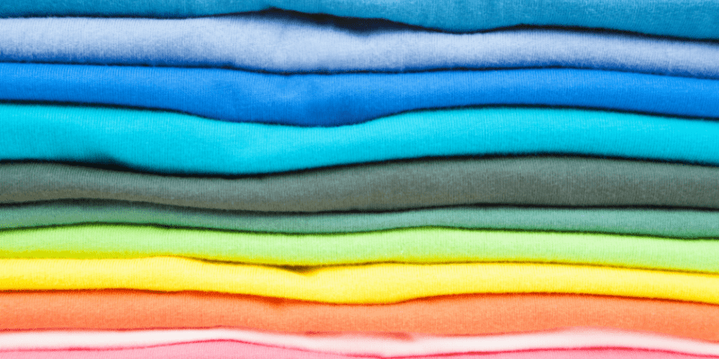 Stack of colored t-shirts—What To Wear on a First Date with a Cancer Man