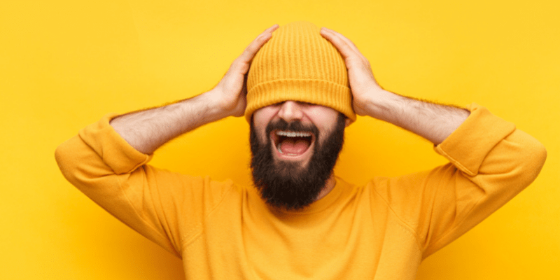 Bearded man with yellow hat covering his eyes—What does it mean when a girl says aww you're so sweet